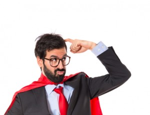 Businessman dressed like superhero thinking over white